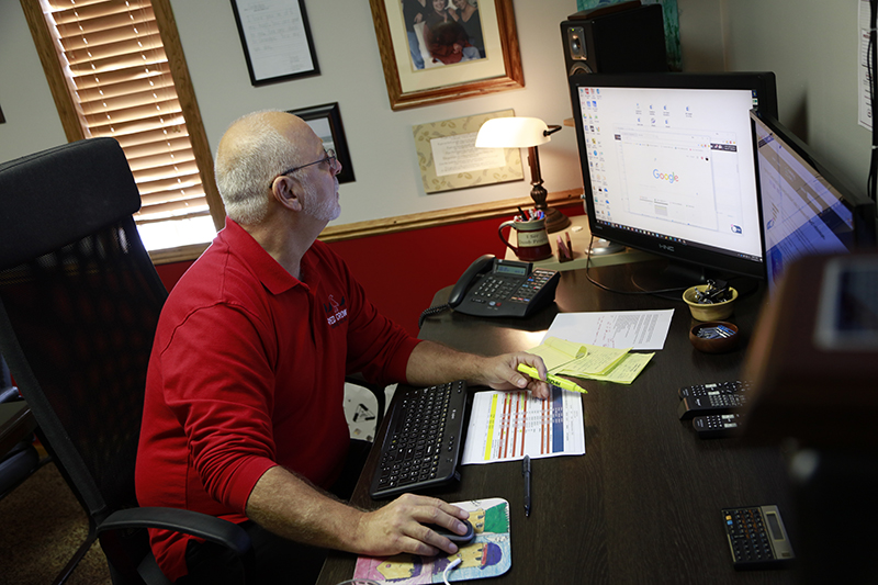 Ron Marshall working at his desk at RCM